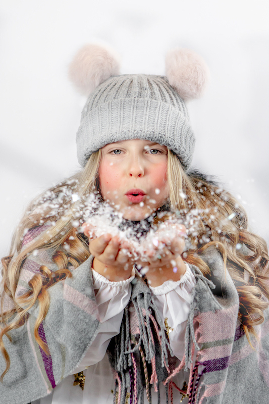 Kyla blowing Snow Christmas Mini Session - Emma Lowe Photography in Rugby